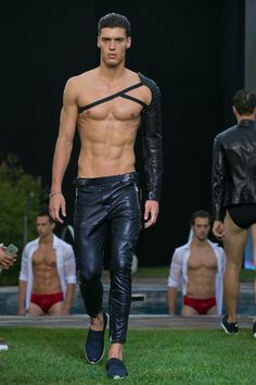 """MILAN – Dirk Bikkembergs' Spring/Summer 2016 man is on a quest for balance and overall self-renewal. Set in the gardens of Terme Milano, Bikkembergs' """"sport couture"""" collection possessed referen. Men Wearing Rings, Mode Cyberpunk, Leather Men, Leather Pants, Hommes Sexy, Wedding Men, Wedding Bands, Hot Boys, Male Body"""