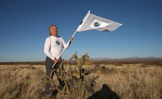 "Sir Richard Branson flying the Virgin Galactic flag. On April 1, 2011 he announced that he had bought Pluto and had a plan to get it reinstated as a planet. He said, ""Virgin has expanded into many territories over the years, but we have never had our own planet before. This could pave the way for a new age in space tourism."" Mona Evans, ""Astronomy April Fools"" http://www.bellaonline.com/articles/art183019.asp"