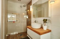 The same wood tones from the main bathroom are carried into the en-suite......Jo and Damo's Master Bedroom The Block NZ 2014