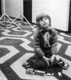 Actor Danny Lloyd between takes on the Hotel Corridor set of The Shining.