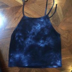 Brandy Melville halter tank top Blue and white tie dye cotton halter tank top. Very comfortable but not very long, so it wi be like a crop top on most Brandy Melville Tops Tank Tops