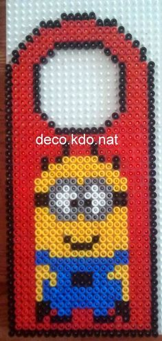To cheer my wee one up. :( Minion door hanger hama perler beads by Deco.Kdo.Nat