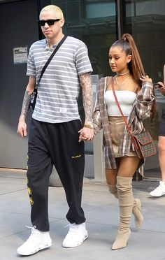 """After several weeks of dating, Ariana Grande and Pete Davidson became engaged in June. """"It's a recent engagement. They're just two people who found love quickly and make each other happy all the time,"""" a source close to the couple told PEOPLE at the time. Ariana Grande Fotos, Ariana Grande 2018, Ariana Grande Concert, Ariana Grande Photoshoot, Ariana Grande Pictures, Ariana Grande Real Hair, Ariana Grande Eyeliner, Ariana Grande Outfits Casual, Ariana Grande Ponytail"""