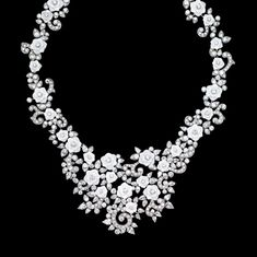 #PiagetRose necklace in 18k white gold set with 404 brilliant-cut diamonds (approx. 29.83 ct), 37 pear-cut diamonds (approx. 11.43 ct) and sculpted white chalcedony.