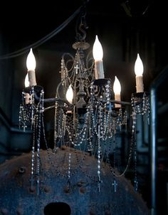 I wondered it this existed...hang vintage rosary beads from a chandelier. from shannonkoszyk.com