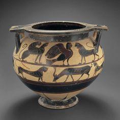A Corinthian Black Figure Column Krater  Culture  : Archaic Greek  Period  : ca. 590-570 B.C.  Material  : Greek Ceramic  Dimensions  : H: 29.8 cm