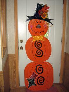 Pumpkin man yard art