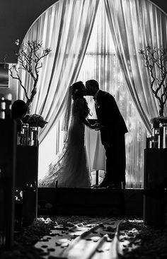 The Villa in Westminster, CA. www.thevillabanquets.com | www.lifetimewedding.com  Wedding ceremony inside The Villa Banquets ballroom.  Manzanita trees.  Romantic!