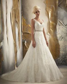 Mori Lee wedding dress #1915 at Glamourous Gowns.