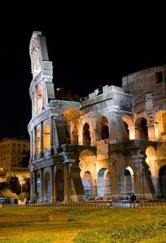 Colosseum at Night, Rome, Italy  Want to go here? Our awesome travel agents can hook you up! http://www.cruisemagic.com
