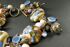 Umbrella Charm Bracelet. Lampwork Glass and Gemstone by Gilliauna, $284.00