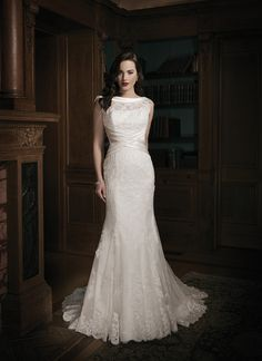 Justin Alexander wedding dresses style 8688 A regal satin rolled collar accents this lace illusion Sabrina neckline.  A satin basket weave cummerbund cinches at the waist line. This  gorgeous lace and tulle gown gives a fit and flare silhouette. The  V-neckline back flows into a chapel length train and has satin buttons  over the back zipper.