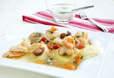 ***RAVIOLI & SHRIMP ***** AWESOME recipe! Flavors are wonderful! My additions: I used another glove of garlic. My changes: Saute' garlic and shrimp together for a minute - turn shrimp, cook for another minute. Remove BOTH shrimp and garlic from pan - continue with recipe directions. When adding shrimp back into pan, stir well to coat everything in sauce, reduce heat, cover and simmer for 5 minutes.