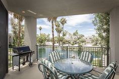 This 2 BR/2BA townhome is tucked away in a quiet Gainey Ranch location overlooking the Sunset Cove lagoon and fountains.