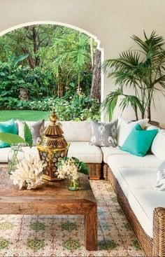 A coastal backyard living area with a touch of gold decor