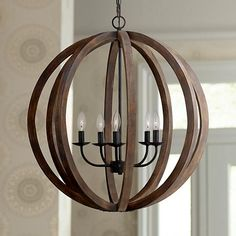 From the Feiss lighting collection, this orb chandelier features antique style, forged iron details and a rustic flair.