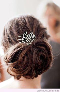 This rhinestone hair comb accentuates a romantic loose bun, wonderful
