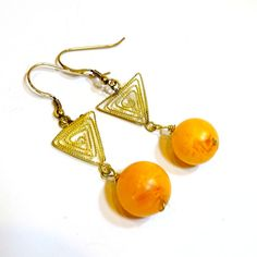 African filigreed brass and amber copal dangle by FIPDesigns