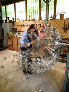 Our steel sculpture dandelions are made from stainless steel wire with copper leaves. The normal garden size dandelions stand around 6 foot highabstract sculpture made from paper mache, wire, and tree stumpTalented artist at work with wire. They bend Steel Sculpture, Sculpture Art, Abstract Sculpture, Art En Acier, Sculptures Sur Fil, Wire Sculptures, Fantasy Wire, Memes Arte, Metal Garden Art