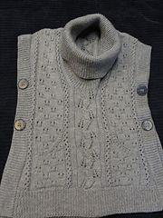 http://www.ravelry.com/projects/bigD/tabard-vest---shawl-collar-slipover