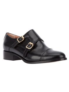 Black leather shoes from Semi Couture featuring a round closed toe, two buckle fastening straps and a low heel.