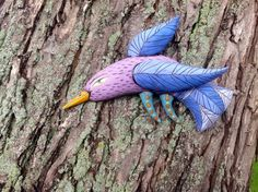 Lilac Bird with Blue Wings $75