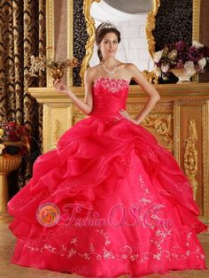 New Coral Red Sweet 16 Dress Strapless Embroidery Organza Ball Gown  http://www.fashionos.com    This red quinceanera dress is so brilliant . It features a lovely strapless bodice with embroidery throughout. The A-line skirt features two tiers. The top one is ruffled and split to reveal the heavily embellished underskirt.A corset-style closure in the back secures the dress in place. This one puts you to mind of a traditional southern belle.