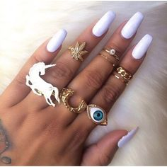 Jewels: long nails finger rings ring gold weed eye nail polish white... ❤ liked on Polyvore featuring nails