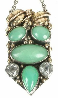 Dorrie Nossiter (in the manner of). An Arts and Crafts pendant, possibly adapted from a clip, set with chrysoprases and white paste. 7 cm long. Sold by Dreweatt Neate.