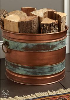 Give your fireplace an authentic appearance this fall with this Hampshire Firewood Holder, crafted of real copper and decorated with two bands of verdigris. This firewood holder has a unique aged appearance that makes a delightful accent to your hearth.