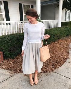 Courtney Toliver wearing linen buttoned skirt by Mary's outfit