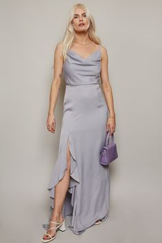 Satin slip dresses are always in style, and this one features a timeless cowl neck that's flattering on big and small busts alike. The fluid satin skirt moves beautifully while the lace and ruffle-trimmed thigh split detail make it feel ultra-luxe. One your maids will want to wear after the wedding too.                    A bridesmaid satin maxi dress with cowl neck detail and thigh slit with lace insert  .      Ref: U18865D1A    Model wears a size 8.    97%polyester 3%elastane.    COOL HAND WAS Luanna, Embellished Dress, Fitted Bodice, Purple Dress, Mistress, Lace Insert, Bridesmaid Dresses, Satin, Cowl Neck