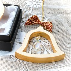 Handcrafted to the last detail from quality wood, hand gilded and completed with luxury ribbon and radiant cut crystal Wooden Angel, Wooden Fish, Wooden Stars, Radiant Cut, Luxury Gifts, Wood Art, Art Pieces, Ribbon, Hand Painted