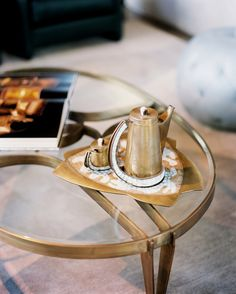 Glass And Brass Coffee Photo - A glass-and-brass coffee table