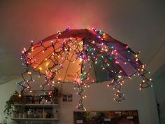 "Umbrella & fairy lights chandelier at 'Garden Gate Child Development Center' ("",)"