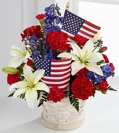 he FTD® American Glory™ Bouquet bursts with patriotic pride and heartfelt beauty. Blue delphinium, bright red carnations and mini carnations, and brilliant white Asiatic lilies.