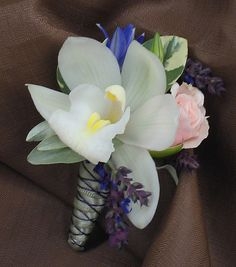 2 - Nice idea for the corsage pins or boutineres.like the neutrals with the purples. Like the different textures, but not necessarily the plain orchid. Orchid Boutonniere, Boutonnieres, Green Wedding, Wedding Flowers, Orchid House, Corsage Pins, Order Flowers Online, Cymbidium Orchids, Different Textures