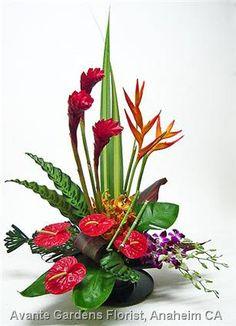 contemporary tropical pedestal floral design   Contemporary Tropical Arrangement