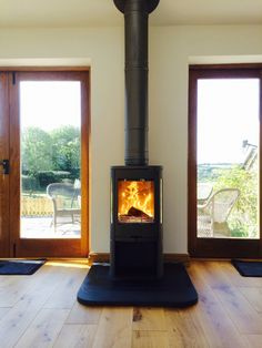 A woodburner with no chimney & a glass door. Small spaces external walls.