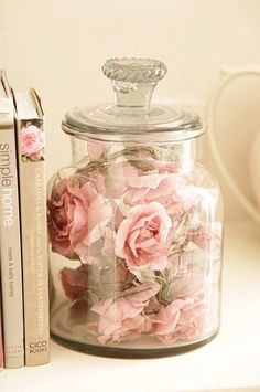 Dried roses in a pretty glass jar with lid. Great way to preserve and display meaningful flowers