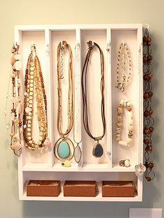 Old drawer with silverware / utensil dividers, hung vertically on the wall, add hooks = jewelry organizer. Up Cycle DIY