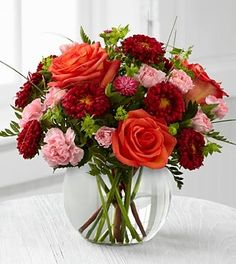 Arranged in a clear glass bubble bowl, this bouquet will spread smiles at every turn.