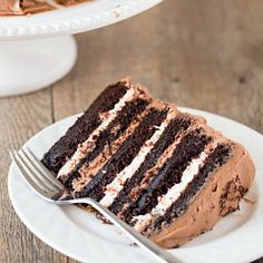 Six-Layer Chocolate Cake with Toasted Marshmallow Filling & Malted Chocolate Frosting from @Michelle (Brown Eyed Baker)