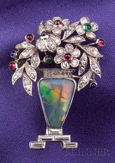 Art Deco Brooch | Platinum with Black Opal, Diamonds, Rubies, and Emeralds, and Sapphires