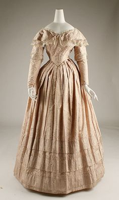 Dress  Date: 1845–46 Culture: European Medium: silk Dimensions: Length at CB: 52 1/4 in. (132.7 cm) Credit Line: Catharine Breyer Van Bomel Foundation Fund, 1981 Accession Number: 1981.210.3