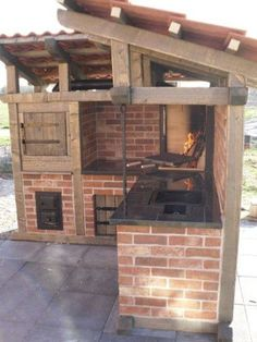 Pretty intricate outdoor kitchen. Eaves, lots of cabinets, the works. (via glen)