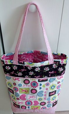 """""""Shopper's Fancy Tote"""" from Jo-Lynda's Attic from pin: http://pinterest.com/pin/192528952792449438/    I didn't like how large the outer pockets ended up being - there's not enough of the quilted fabric showing, IMO.  So next time I'll make those smaller.  I divided them into one two-part pocket and one three-part pocket.  I was so proud, too - I sewed a zipper!  I do like the zippered inside pocket.    One thing I might change is to make a milk carton box bottom, also."""