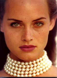 Amber Valletta | lip color + pearls
