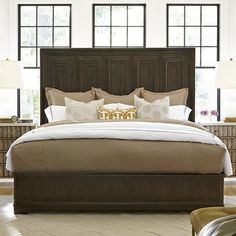 Bring stately style to your master suite or guest bed with this lovely bed, showcasing an eye-catching molding design.