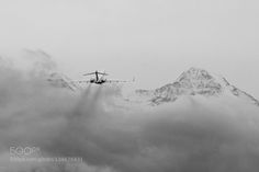 Popular on 500px : Fly away over the Mountains by jorisschneiter